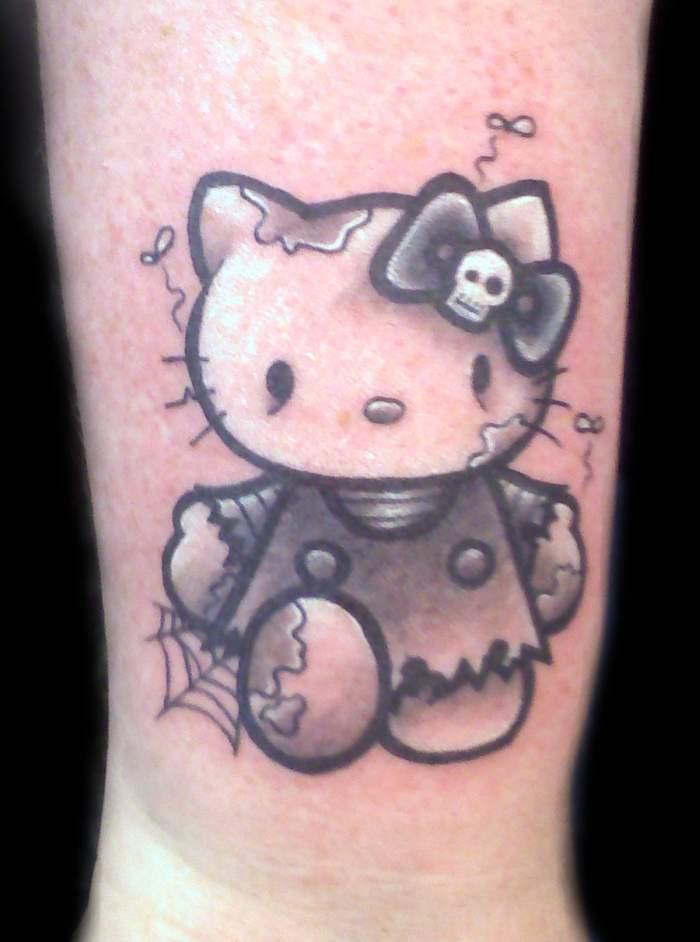 Tatouage hello kitty avec une toile daraigné - Inkage