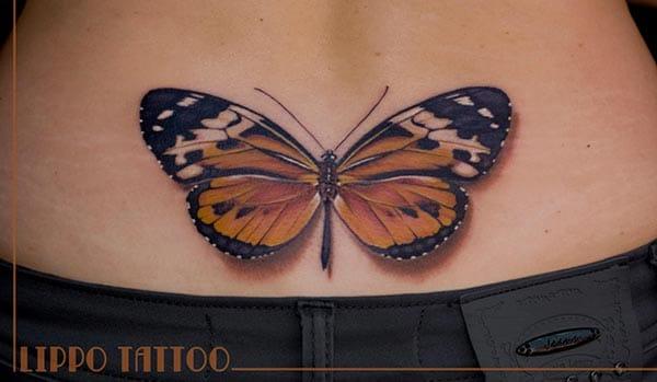 Tatouage Papillon Marron Dans Le Bas Du Dos Inkage