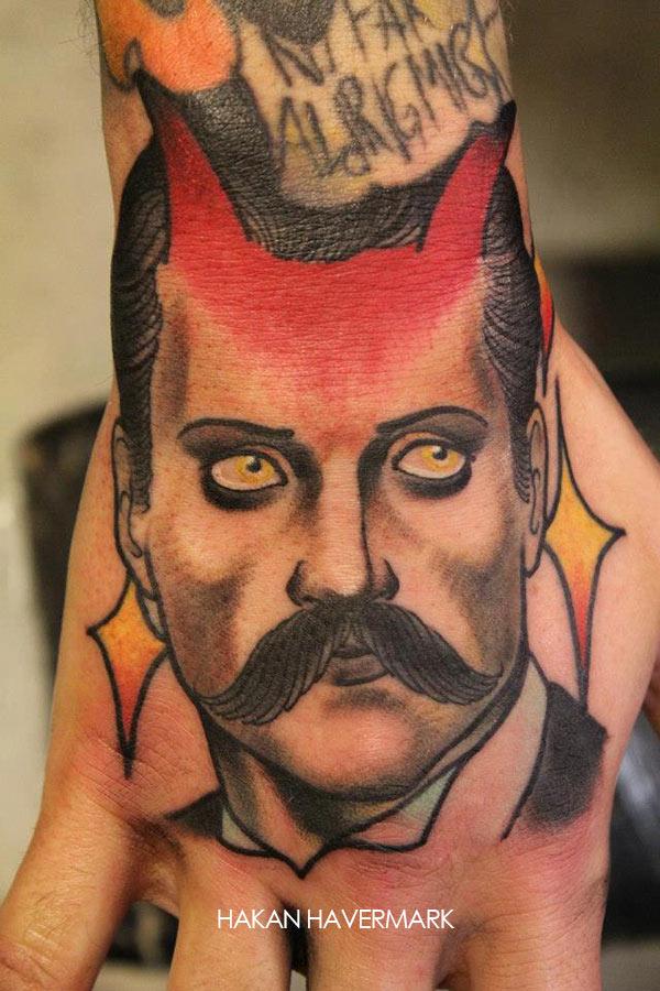 Tatouage D Un Homme Avec Des Moustache Et Des Cornes Inkage